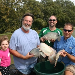 Bob Lusk, staff and granddaughter harvest tilapia at LL,2